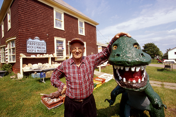 Eldon George in front of the Parrsboro Rock and Mineral Shop. Photo Credit: National Geographic Travel Magazine, 2004.